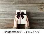 female hands holding gift box... | Shutterstock . vector #314124779