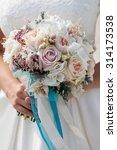 bride with bouquet  closeup | Shutterstock . vector #314173538