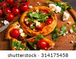 tasty mini pizza with tomatoes...   Shutterstock . vector #314175458