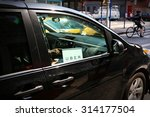 Small photo of New York, US - 29 August 2015. Uber car service on the streets of New York