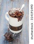 chocolate caramel cake in a mug | Shutterstock . vector #314191490