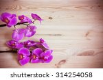 pink orchid flowers on a wooden ...   Shutterstock . vector #314254058