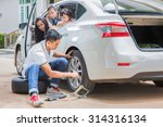 father change tire and his... | Shutterstock . vector #314316134