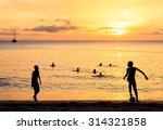 Stock photo childrens silhouette playing soccer at tarrafal beach in santiago island in cape verde cabo verde 314321858