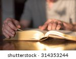 man reading the bible in dim... | Shutterstock . vector #314353244