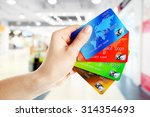Hand Holding Credit Cards On...