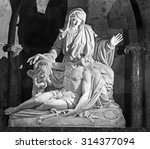 Small photo of MALAGA, SPAIN - MAY 31, 2015: The white marble Pieta by Pisani brothers (1802) in the Cathedral.