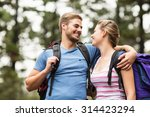 young happy hikers looking at... | Shutterstock . vector #314423294