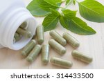 herb capsules spilling out of a ... | Shutterstock . vector #314433500