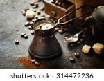old coffee pot and mill on dark ... | Shutterstock . vector #314472236