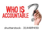 Small photo of Hand with marker writing the word Who Is Accountable?