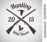 hunting vintage emblem. cross...