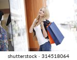 woman with paper bags looking