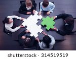 business team solving puzzle... | Shutterstock . vector #314519519