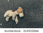 toy dog abandoned on the... | Shutterstock . vector #314522066