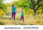 mother with child running in... | Shutterstock . vector #314529434