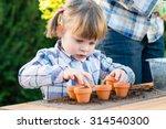 Child Girl Planting Flower...