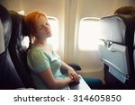 sleeping woman in the chair on... | Shutterstock . vector #314605850