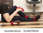 Small photo of Adultery. Low section of business couple getting intimate on floor in office