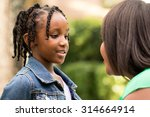 mother talking with her... | Shutterstock . vector #314664914