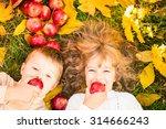 Happy Children Lying On Fall...