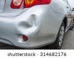A Car Has A Dented Rear Bumper...