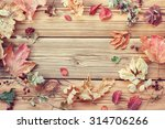 Autumn Leaves On A Wooden...