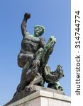Small photo of Allegorical statue of fight versus evil on the Gellért Hill - Budapest
