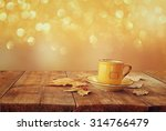 front image of coffee cup over... | Shutterstock . vector #314766479