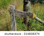 """footpath follows hedge"" sign..."