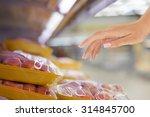 female hand and  raw chicken... | Shutterstock . vector #314845700