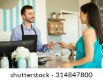 young brunette paying with a... | Shutterstock . vector #314847800