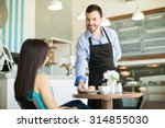 friendly young waiter serving a ... | Shutterstock . vector #314855030