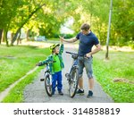 father and son give high five... | Shutterstock . vector #314858819