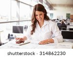 female architect at work in an... | Shutterstock . vector #314862230