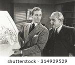 going over design plan | Shutterstock . vector #314929529
