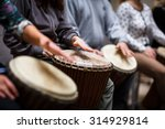 Small photo of Group of people playing on drums - therapy by music
