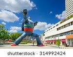 KOBE, JAPAN - AUGUST 22, 2015: The Gigantor robot monument at Shin-nagata Station. The character is from the manga Testsujin 28-go written by the late Mitsuteru Yokoyama who was born in Kobe. - stock photo