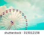 Ferris Wheel On Cloudy Sky...