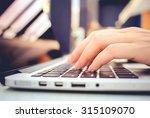 female hands typing on keyboard ... | Shutterstock . vector #315109070