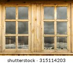 Window In A Wooden House Made...