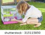 girl in the backyard playing... | Shutterstock . vector #315115850