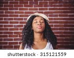young woman posing with hat on... | Shutterstock . vector #315121559