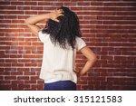 young woman scratching her head ... | Shutterstock . vector #315121583