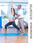 pregnant woman stretching while ... | Shutterstock . vector #315126710