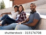 group of students sitting on... | Shutterstock . vector #315176708