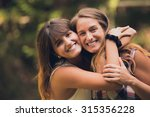two sisters hugging each other... | Shutterstock . vector #315356228