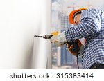 builder or worker drilling with ... | Shutterstock . vector #315383414