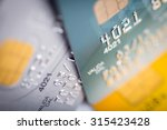 close up of a green credit card  | Shutterstock . vector #315423428