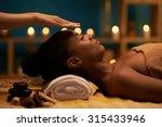 therapist holding hands above... | Shutterstock . vector #315433946
